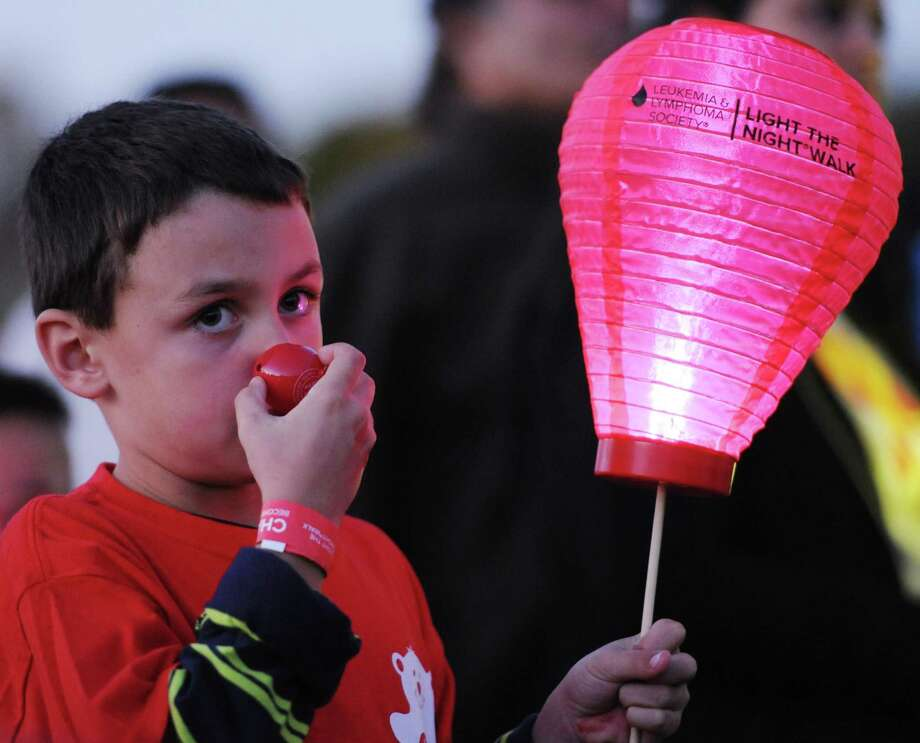A participant wears a clown nose at the Light the Night Walk cancer fundraiser at Newtown Youth Academy in Newtown, Conn. on Saturday, Sept. 2, 2013.  Over 400 people walked the two-mile route around the Fairfield Hills campus, carrying illuminated ballons - red for supporters, white for survivors and gold for those who lost loved ones to cancer. Photo: Tyler Sizemore / The News-Times