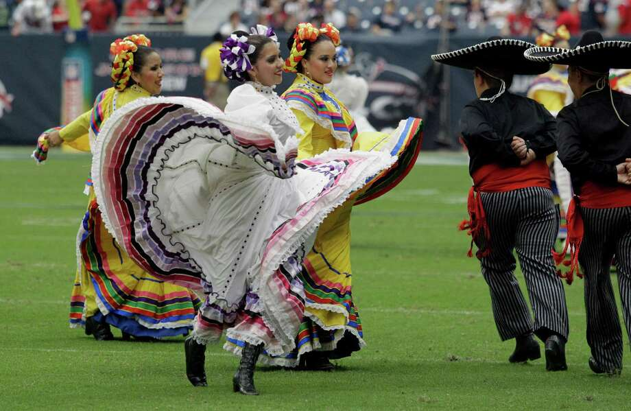 Dancers perform during halftime of an NFL football game between the Seattle Seahawks and Houston Texans as part of Hispanic Heritage Month Sunday, Sept. 29, 2013, in Houston. (AP Photo/Patric Schneider) Photo: Patric Schneider, Associated Press / FR170473