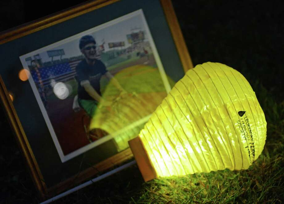 Sandy Hook resident Chrissy Hadgraft's gold balloon sits beside a photo of Matthew Starring, who died of cancer in 2009, at the Light the Night Walk cancer fundraiser at Newtown Youth Academy in Newtown, Conn. on Saturday, Sept. 2, 2013.  Over 400 people walked the two-mile route around the Fairfield Hills campus, carrying illuminated ballons - red for supporters, white for survivors and gold for those who lost loved ones to cancer. Photo: Tyler Sizemore / The News-Times