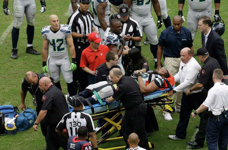 Seattle Seahawks' Michael Bennett is carted off the field after he was injured during the second quarter an NFL football game against the Houston Texans, Sunday, Sept. 29, 2013, in Houston. (AP Photo/David J. Phillip) Photo: David J. Phillip, Associated Press / AP