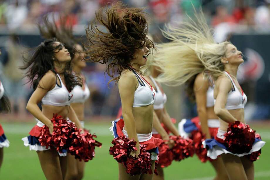 The Houston Texans cheerleaders dance during the fourth quarter of an NFL football game against the Seattle Seahawks Sunday, Sept. 29, 2013, in Houston. (AP Photo/David J. Phillip) Photo: David J. Phillip, Associated Press / AP