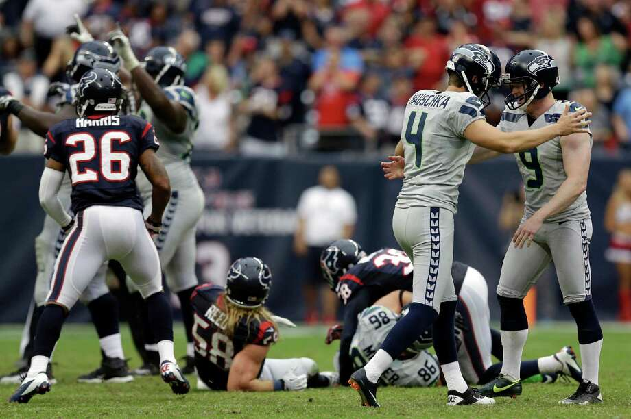 Seattle Seahawks' Jon Ryan (9) celebrates with kicker Steven Hauschka (4) after Hauschka kicked the winning field goal against the Houston Texans during overtime of an NFL football game on Sunday, Sept. 29, 2013, in Houston. Seattle won 23-20. (AP Photo/David J. Phillip) Photo: David J. Phillip, Associated Press / AP