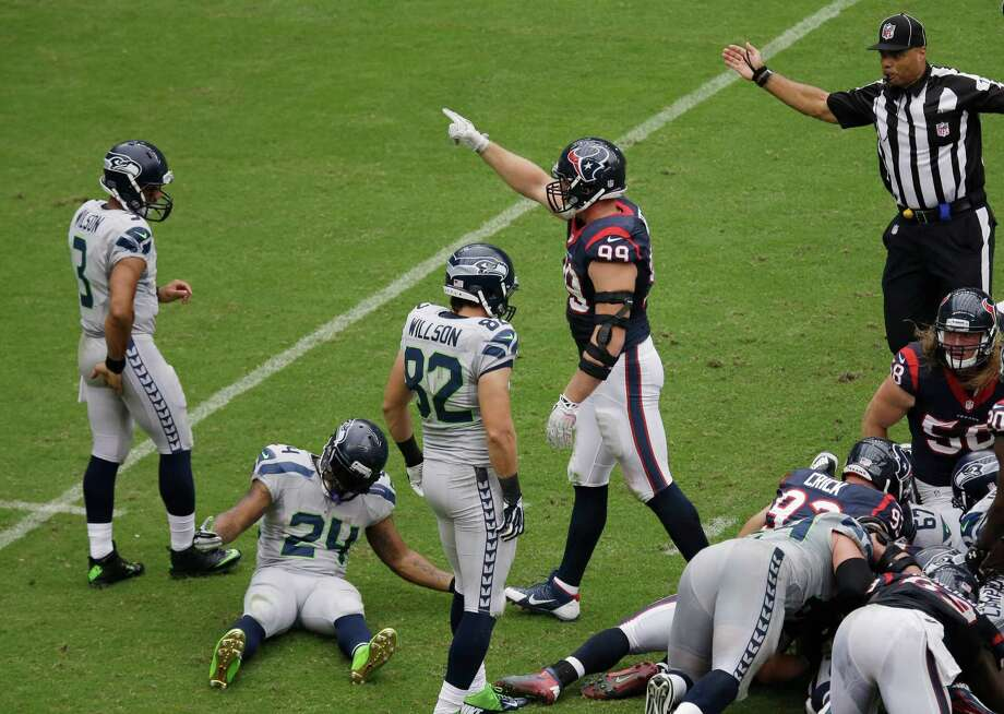 Seattle Seahawks' Marshawn Lynch (24) reacts after he turned the ball over with a fumble after he was hit by Houston Texans' Brian Cushing during the second quarter an NFL football game on Sunday, Sept. 29, 2013, in Houston. Houston recovered the ball. (AP Photo/David J. Phillip) Photo: David J. Phillip, Associated Press / AP