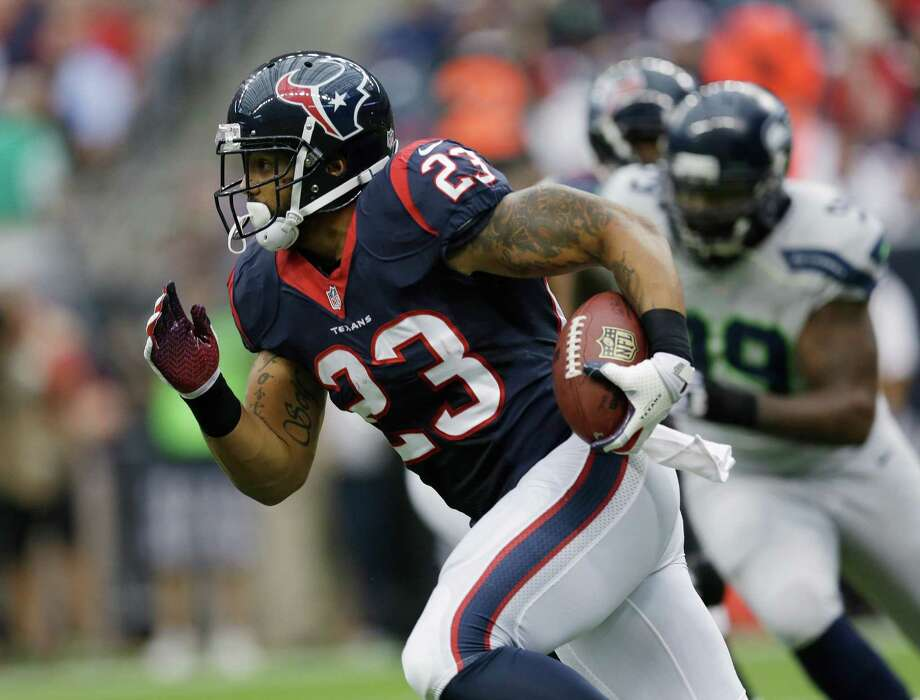 Houston Texans' Arian Foster (23) runs against the Seattle Seahawks during the first quarter an NFL football game Sunday, Sept. 29, 2013, in Houston. (AP Photo/David J. Phillip) Photo: David J. Phillip, Associated Press / AP