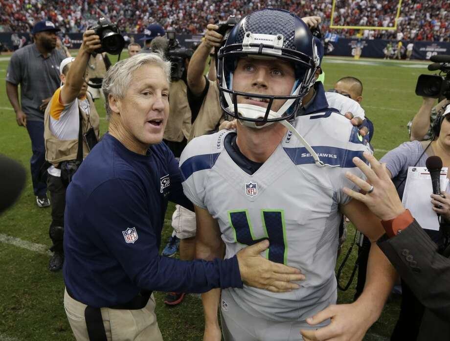 Seattle Seahawks head coach Pete Carroll, left, celebrates with Steven Hauschka after Hauschka kicked the winning field goal against the Houston Texans during overtime of an NFL football game Sunday, Sept. 29, 2013, in Houston. Seattle won 23-20. Photo: David J. Phillip, Associated Press