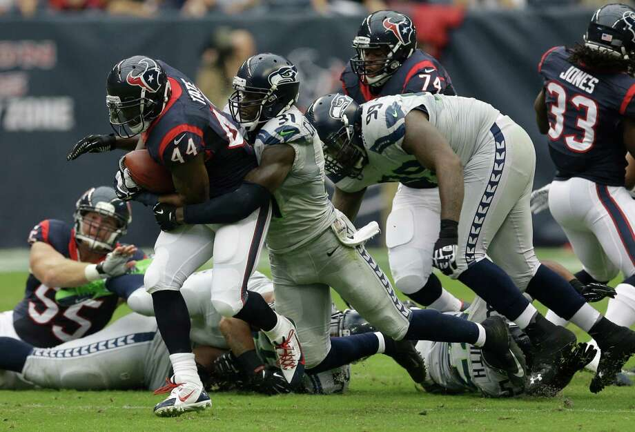 Houston Texans running back Ben Tate (44) runs for extra yards during the first quarter an NFL football game against the Seattle Seahawks Sunday, Sept. 29, 2013, in Houston. (AP Photo/David J. Phillip) Photo: David J. Phillip, Associated Press / AP