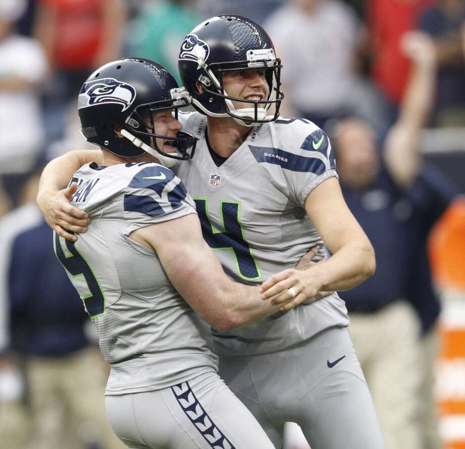 Seattle Seahawks' Steven Hauschka celebrates with holder Jon Ryan after kicking a 45-yard game-winning field goal during overtime against the Houston Texans in an NFL football game Sunday afternoon, Sept. 29, 2013, in Houston. The Seahawks won 23-20. (AP Photo/The Galveston County Daily News, Kevin M. Cox) MANDATORY CREDIT  TV OUT Photo: AP