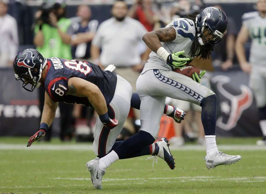 Seattle Seahawks' Richard Sherman (25) intercepts the ball in front of Houston Texans' Owen Daniels (81) during the fourth quarter an NFL football game on Sunday, Sept. 29, 2013, in Houston. Sherman returned the ball for a touchdown. Photo: Patric Schneider, Associated Press