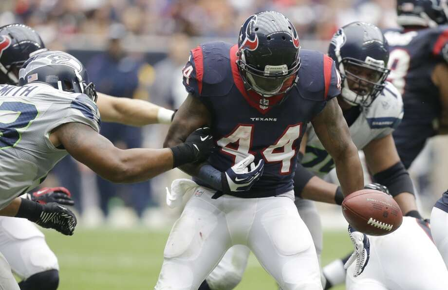 Seattle Seahawks' Malcolm Smith, left, causes Houston Texans' Ben Tate (44) to fumble during the third quarter an NFL football game on Sunday, Sept. 29, 2013, in Houston. Photo: Patric Schneider, Associated Press