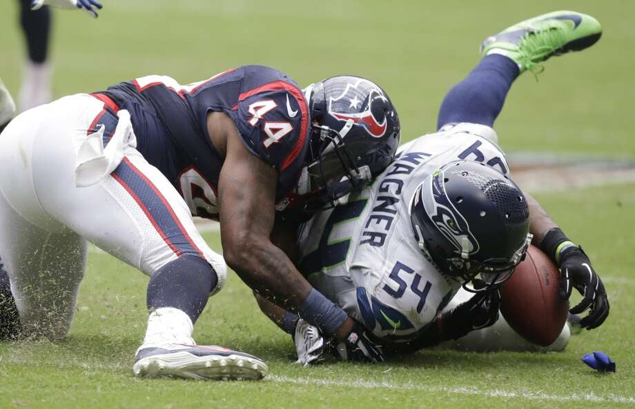 Seattle Seahawks' Bobby Wagner (54) recovers the ball after Houston Texans' Ben Tate (44) fumbled during the third quarter an NFL football game on Sunday, Sept. 29, 2013, in Houston. Photo: Patric Schneider, Associated Press