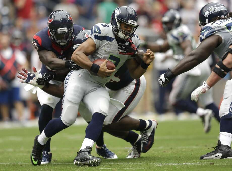 Seattle Seahawks quarterback Russell Wilson (3) is taken down during the first quarter an NFL football game against the Houston Texans Sunday, Sept. 29, 2013, in Houston. Photo: David J. Phillip, Associated Press