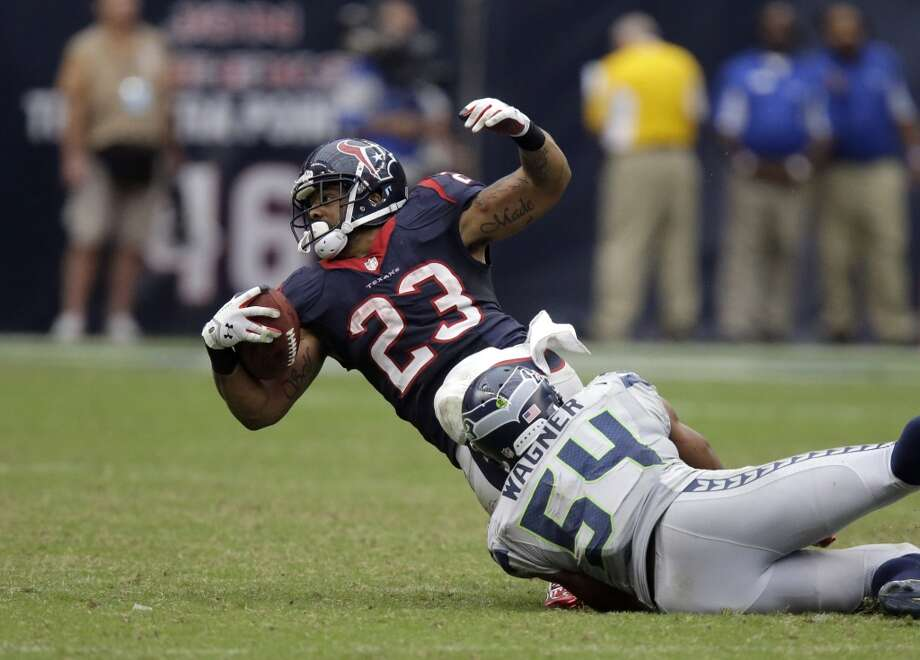 Houston Texans running back Arian Foster (23) is tackled by Seattle Seahawks middle linebacker Bobby Wagner (54) during the fourth quarter an NFL football game Sunday, Sept. 29, 2013, in Houston. Photo: Patric Schneider, Associated Press