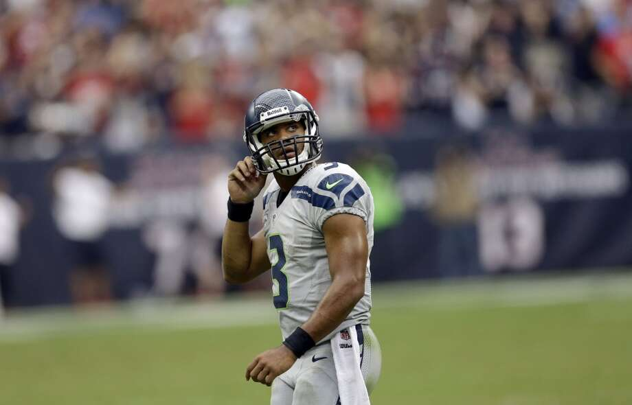 Seattle Seahawks quarterback Russell Wilson (3) looks up at the scoreboard after throwing interception against the Houston Texans during the fourth quarter an NFL football game Sunday, Sept. 29, 2013, in Houston. Photo: David J. Phillip, Associated Press