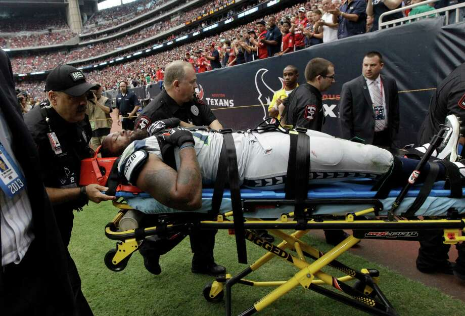 Seattle Seahawks' Michael Bennett is carted off the field after he was injured during the second quarter an NFL football game against the Houston Texans, Sunday, Sept. 29, 2013, in Houston. (AP Photo/Patric Schneider) Photo: Patric Schneider, Associated Press / FR170473