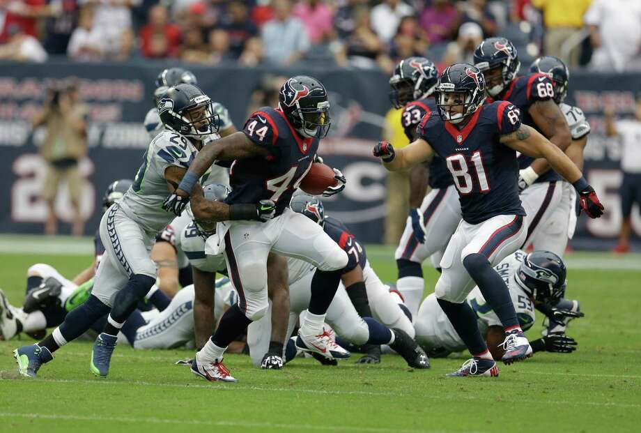 Houston Texans running back Ben Tate (44) runs past Seattle Seahawks safety Earl Thomas (29) during the first quarter an NFL football game Sunday, Sept. 29, 2013, in Houston. (AP Photo/David J. Phillip) Photo: David J. Phillip, Associated Press / AP