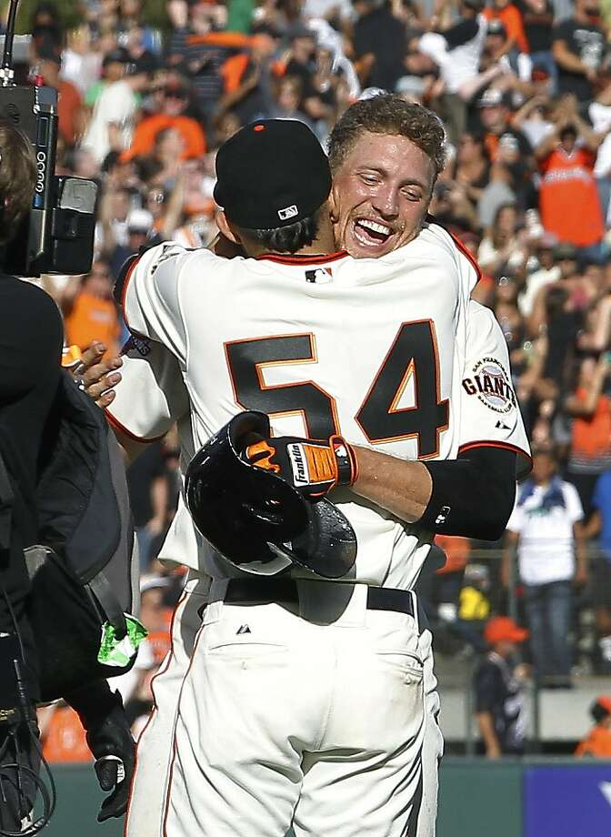 Hunter Pence gets a hug from Sergio Romo (54) after his game-winning hit. Photo: Tony Avelar, Associated Press