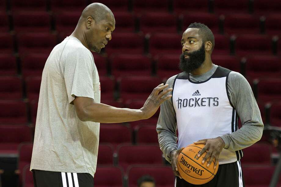 When Hakeem Olajuwon, left, talks, he has the full attention of James Harden and other Rockets. Photo: Smiley N. Pool, Staff / © 2013  Houston Chronicle