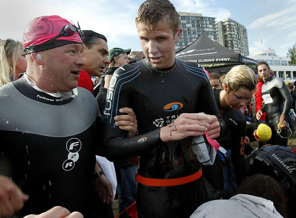 Paul Tiffany (left) helped blind person Max Ashton after his swim Sunday September 29, 2013 in San Francisco, Calif. A small group of blind people from the Foundation for Blind Children joined the annual Alcatraz Invitational Swim sponsored by the South End Rowing Club, becoming the first group of sightless people to swim from the rock to the San Francisco shoreline.