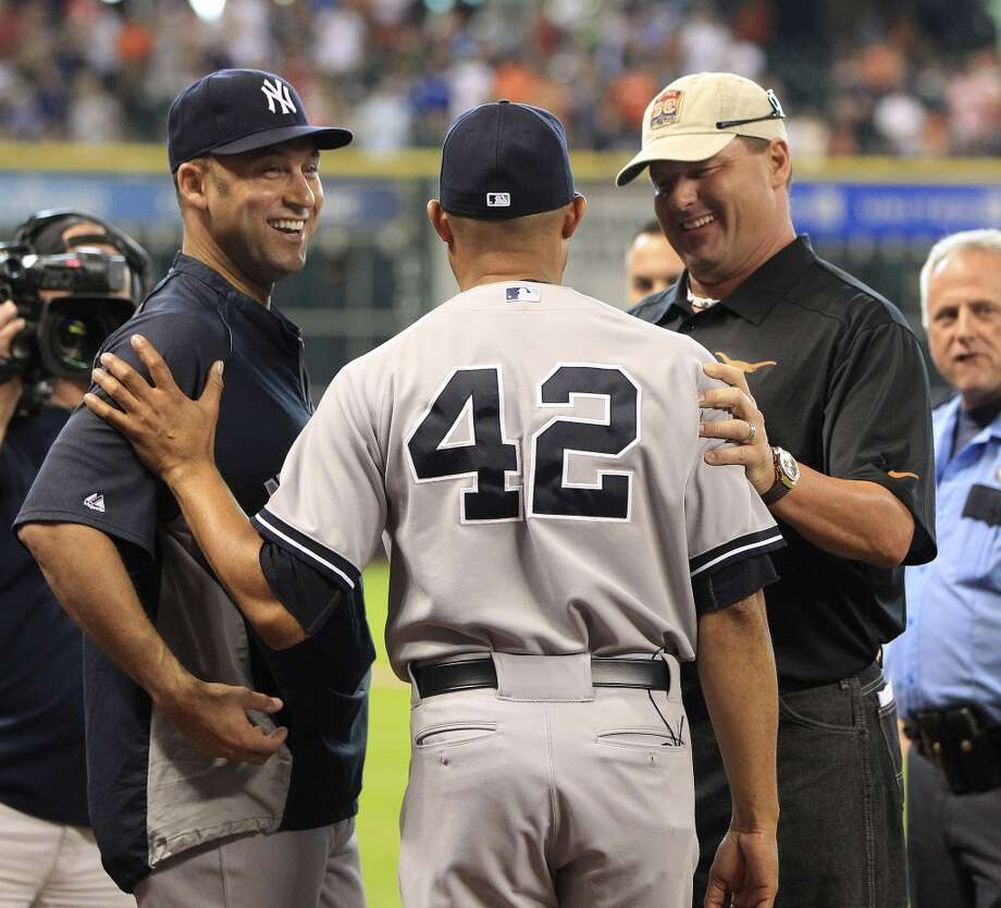 Yankees relief pitcher Mariano Rivera talks with Roger Clemens, and New York Yankees shortstop Derek Jeter before a pre-game ceremony. Photo: Karen Warren, Houston Chronicle