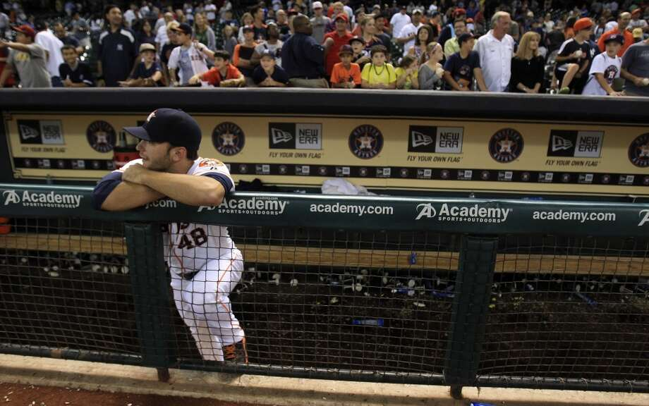 Jarred Cosart reacts in the dugout after the final out. Photo: Karen Warren, Houston Chronicle