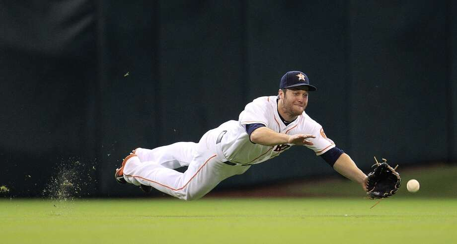 Right fielder Trevor Crowe dives for a double hit by Yankees center fielder Curtis Granderson during the first inning. Photo: Karen Warren, Houston Chronicle