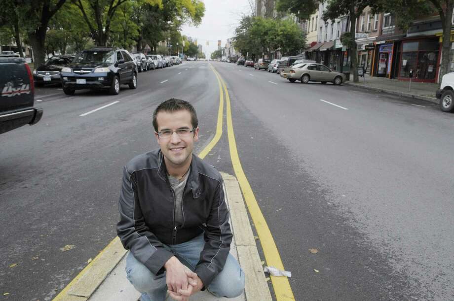 Judd Krasher poses on Central Avenue near the intersection of Henry Johnson Blvd. on Tuesday, Sept. 20, 2011 in Albany.  Krasher has started a drive to form the Lower Central Avenue Neighborhood Association, which would be made up of residents and business owners along Central Ave. from Lark St. to Quail St.  (Paul Buckowski / Times Union) Photo: Paul Buckowski
