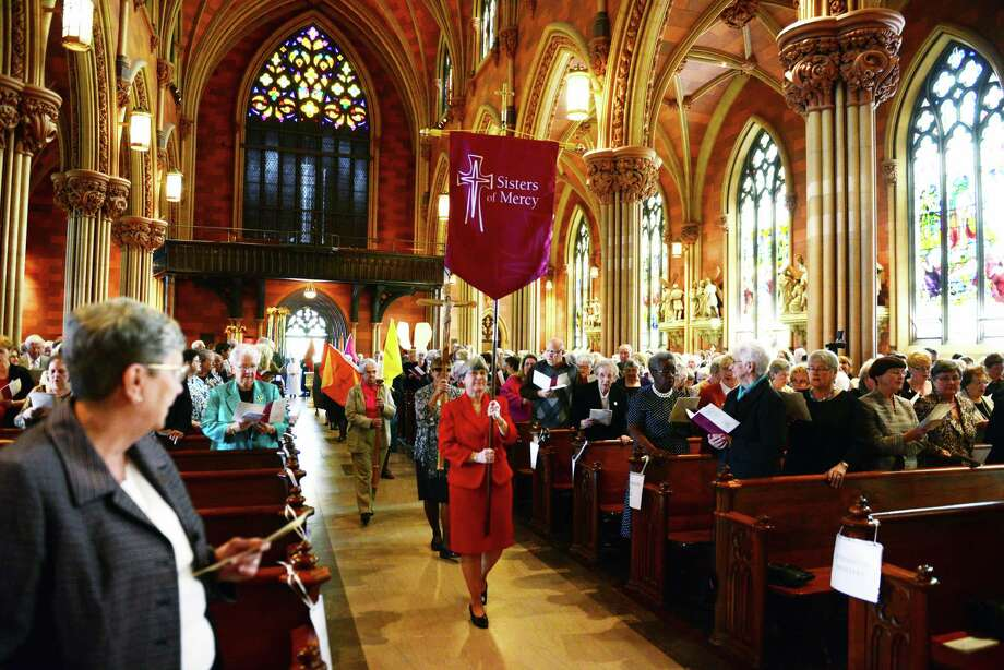 Members of the Sisters of Mercy enter the Cathedral of Immaculate Conception during a special mass by Albany Bishop Howard Hubbard to mark the 150th anniversary of the Sisters Sunday afternoon, Sept. 29, 2013, in Albany, N.Y. There are 86 current Sisters of Mercy of Albany. (Will Waldron/Times Union) Photo: WW / 00024001A