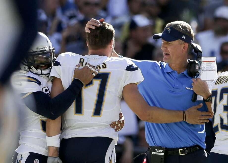 San Diego Chargers head coach Mike McCoy, right, greets quarterback Philip Rivers and Eric Weddle after a touchdown against the Dallas Cowboys during the second half of an NFL football game Sunday, Sept. 29, 2013, in San Diego. (AP Photo/Gregory Bull) Photo: Associated Press