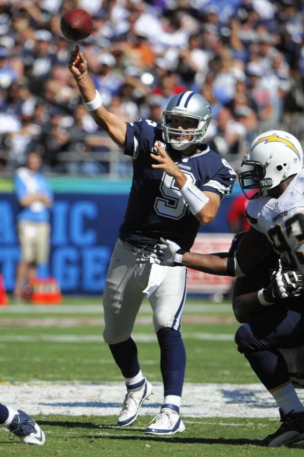 Dallas Cowboys quarterback Tony Romo passes against the San Diego Chargers during the first half of an NFL football game Sunday, Sept. 29, 2013, in San Diego. (AP Photo/Denis Poroy) Photo: Associated Press