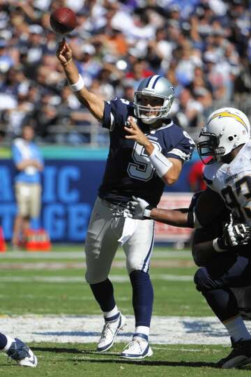 Dallas Cowboys quarterback Tony Romo passes against the San Diego Chargers during the first half of