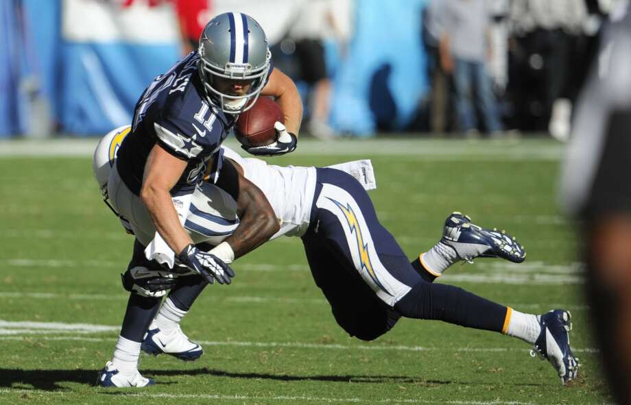 San Diego Chargers defensive back Richard Marshall, right, tackles Dallas Cowboys wide receiver Cole Beasley during the second half of an NFL football game Sunday, Sept. 29, 2013, in San Diego. (AP Photo/Denis Poroy) Photo: Associated Press
