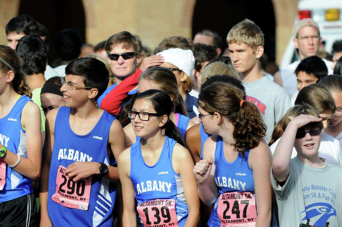 Competitors prepare to start the Albany Booster Cluba€™s first Falcon 5K and Fun Run/Walk Sunday morning, Sept. 29, 2013, at Washington Park in Albany, N.Y. The community event helped to benefit the City School District of Albany. Siblings, Brendan and Eileen Bequette of Albany High School won the mena€™s and womena€™s division with times of 18:56 and 21:21 respectively. (Will Waldron/Times Union)