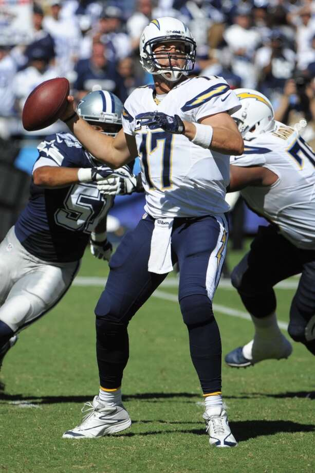 San Diego Chargers quarterback Philip Rivers passes against the Dallas Cowboys during the first half of an NFL football game Sunday, Sept. 29, 2013, in San Diego. (AP Photo/Denis Poroy) Photo: Associated Press