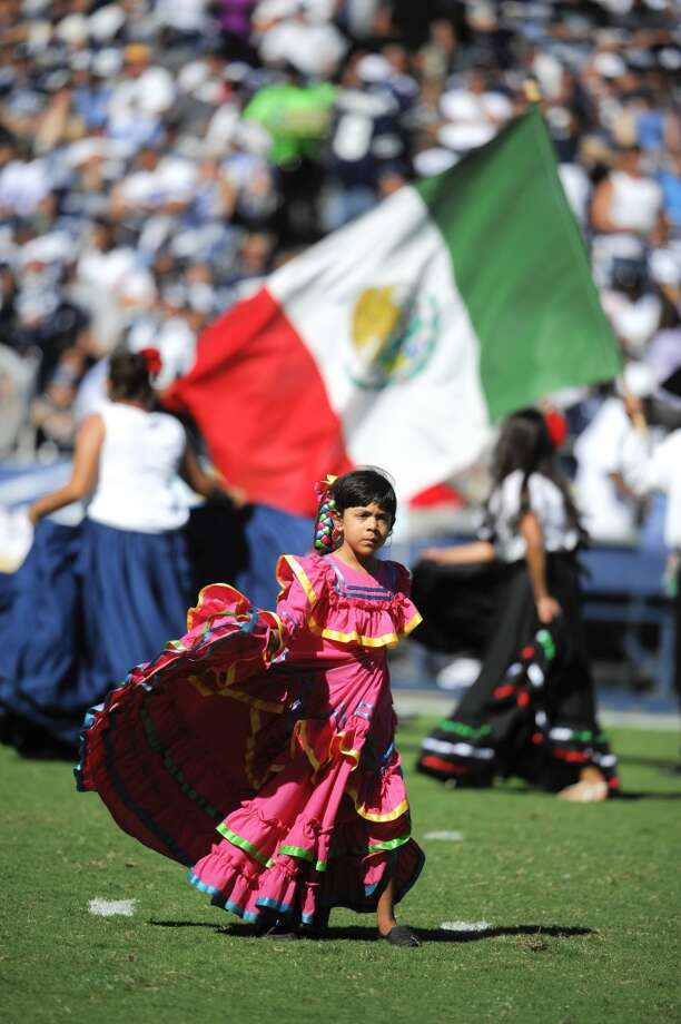 Dancers perform for hispanic heritage month during halftime of an NFL football game between the San Diego Chargers and the Dallas Cowboys Sunday, Sept. 29, 2013, in San Diego. (AP Photo/Gregory Bull) Photo: Associated Press