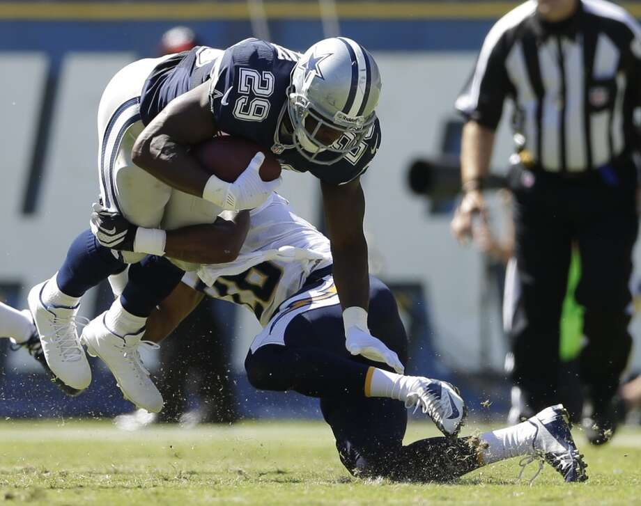 San Diego Chargers cornerback Johnny Patrick, right, tackles Dallas Cowboys running back DeMarco Murray during the first half of an NFL football game Sunday, Sept. 29, 2013, in San Diego. Patrick was hunt on the play.  (AP Photo/Gregory Bull) Photo: Associated Press