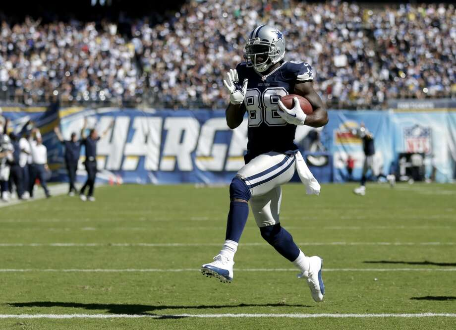 Dallas Cowboys wide receiver Dez Bryant scores against the San Diego Chargers during the first half of an NFL football game Sunday, Sept. 29, 2013, in San Diego. (AP Photo/Gregory Bull) Photo: Associated Press