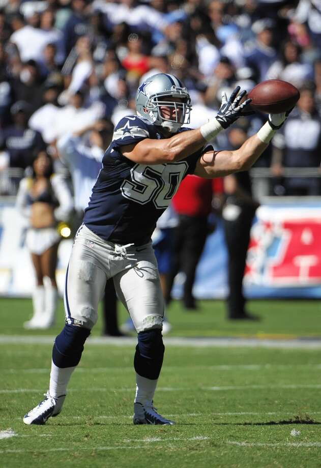 Dallas Cowboys middle linebacker Sean Lee intercepts a pass for a touchdown against the San Diego Chargers during the first half of an NFL football game Sunday, Sept. 29, 2013, in San Diego. (AP Photo/Denis Poroy) Photo: Associated Press
