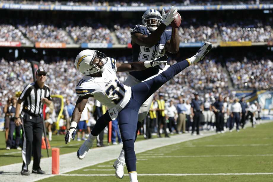 Dallas Cowboys wide receiver Dez Bryant catches a touch down pass as San Diego Chargers defensive back Richard Marshall looks on during the first half of an NFL football game Sunday, Sept. 29, 2013, in San Diego. (AP Photo/Gregory Bull) Photo: Associated Press