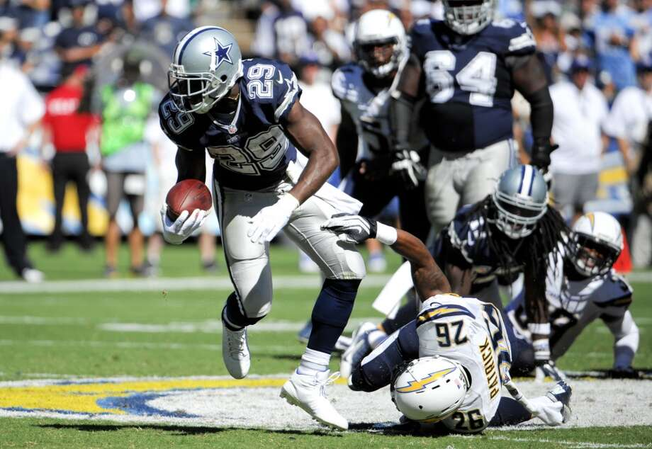 Dallas Cowboys running back DeMarco Murray, left, breaks away form San Diego Chargers cornerback Johnny Patrick during the first half of an NFL football game Sunday, Sept. 29, 2013, in San Diego. (AP Photo/Denis Poroy) Photo: Associated Press