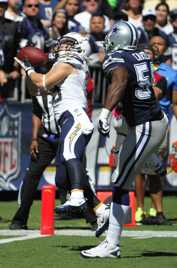 San Diego Chargers running back Danny Woodhead, left, catches a touch down pass in front on Dallas Cowboys outside linebacker Bruce Carter during the first half of an NFL football game Sunday, Sept. 29, 2013, in San Diego. (AP Photo/Denis Poroy) Photo: Associated Press
