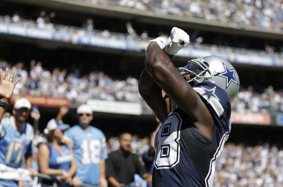 Dallas Cowboys wide receiver Dez Bryant catches celebrates a touch down pass against the San Diego Chargers during the first half of an NFL football game Sunday, Sept. 29, 2013, in San Diego. (AP Photo/Gregory Bull) Photo: Associated Press