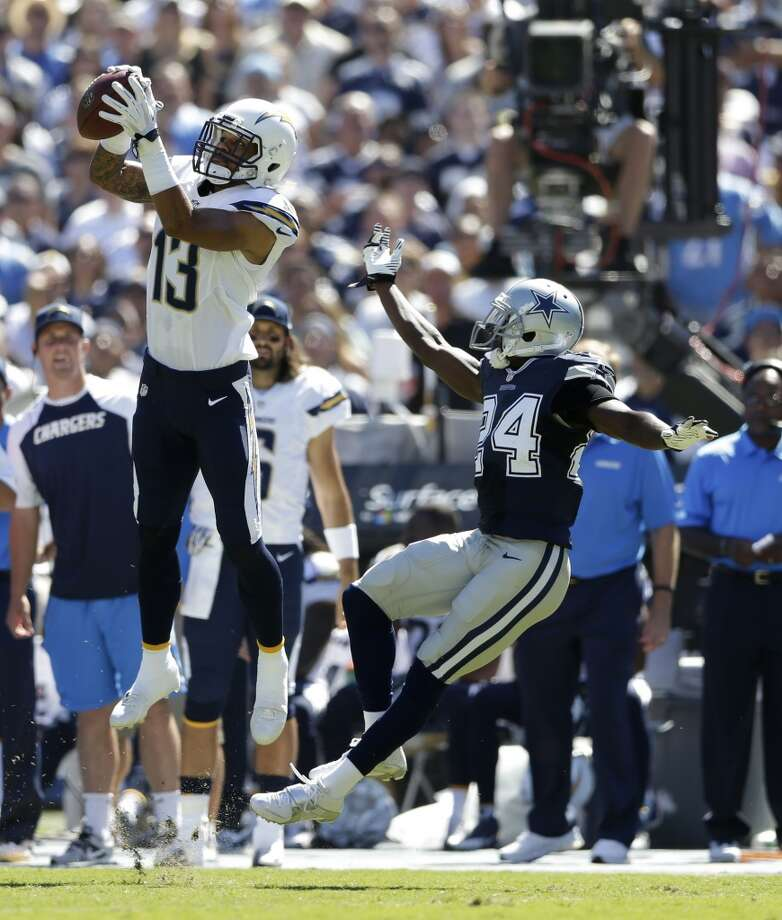 San Diego Chargers wide receiver Keenan Allen catches a pass in front on Dallas Cowboys cornerback Morris Claiborne during the first half of an NFL football game Sunday, Sept. 29, 2013, in San Diego. (AP Photo/Gregory Bull) Photo: Associated Press