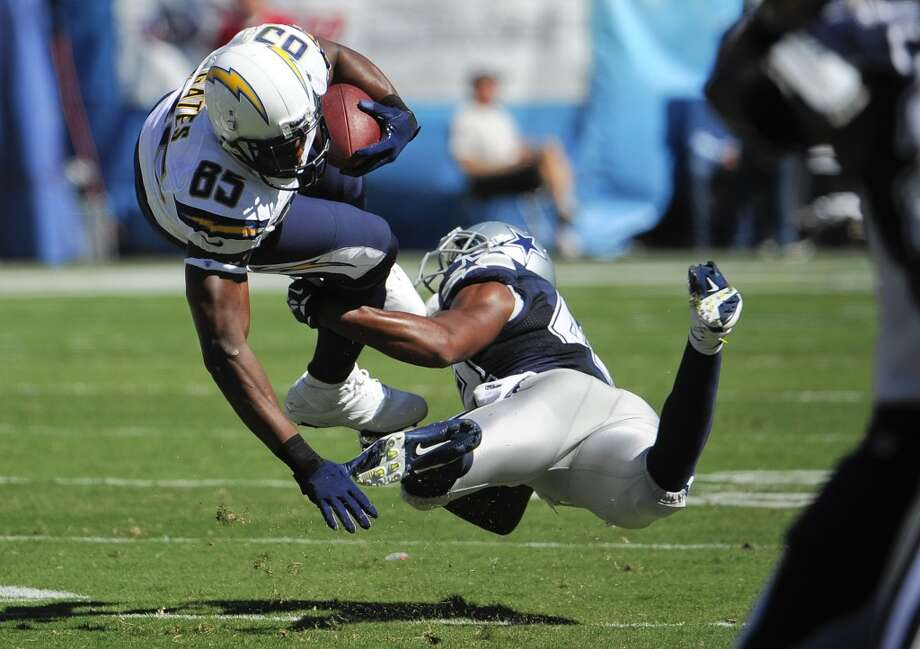 Dallas Cowboys free safety Barry Church, right, tackles San Diego Chargers tight end Antonio Gates during the first half of an NFL football game Sunday, Sept. 29, 2013, in San Diego. (AP Photo/Denis Poroy) Photo: Associated Press