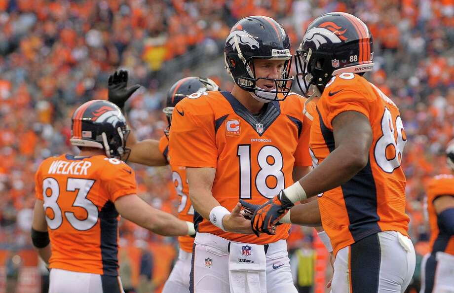 Denver Broncos quarterback Peyton Manning (18) is congratulated by wide receiver Demaryius Thomas (88) after throwing a touchdown pass to Wes Welker against the Philadelphia Eagles in the third quarter  of an NFL football game, Sunday, Sept. 29, 2013, in Denver. (AP Photo/Jack Dempsey)  ORG XMIT: COJJ122 Photo: Jack Dempsey / FR42408 AP