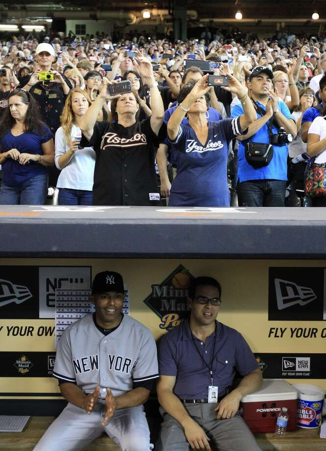 Yankees relief pitcher Mariano Rivera sits in the dugout waiting for his introduction. Photo: Karen Warren, Houston Chronicle