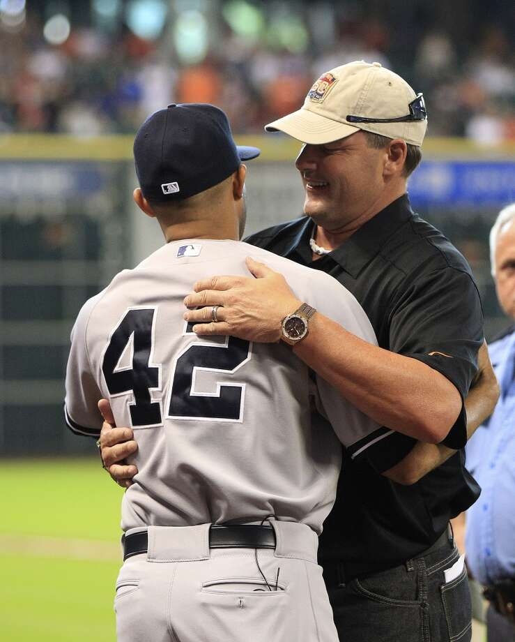 Roger Clemens hugs Yankees relief pitcher Mariano Rivera before a pre-game ceremony . Photo: Karen Warren, Houston Chronicle