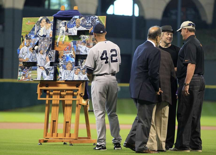Yankees relief pitcher Mariano Rivera looks at a painting that presented to him during a pre-game ceremony. Photo: Karen Warren, Houston Chronicle