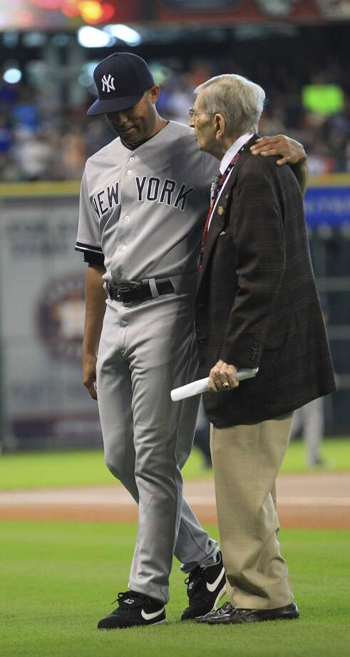 Yankees relief pitcher Mariano Rivera walks back to the dugout with Milo Hamilton after a pre-game ceremony. Photo: Karen Warren, Houston Chronicle