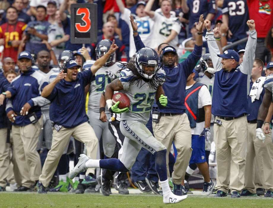 Seahawks cornerback Richard Sherman returns an interception for a touchdown. Photo: Cody Duty, Houston Chronicle
