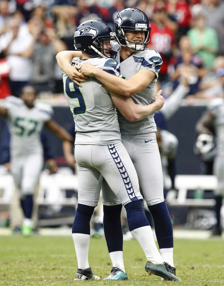 Seahawks punter Jon Ryan celebrates with kicker Steven Hauschka, right, after Hauschka kicked the game-winning field. Photo: Cody Duty, Houston Chronicle